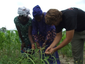 My ancien, Nathan, with two women in Kolda in a bean field